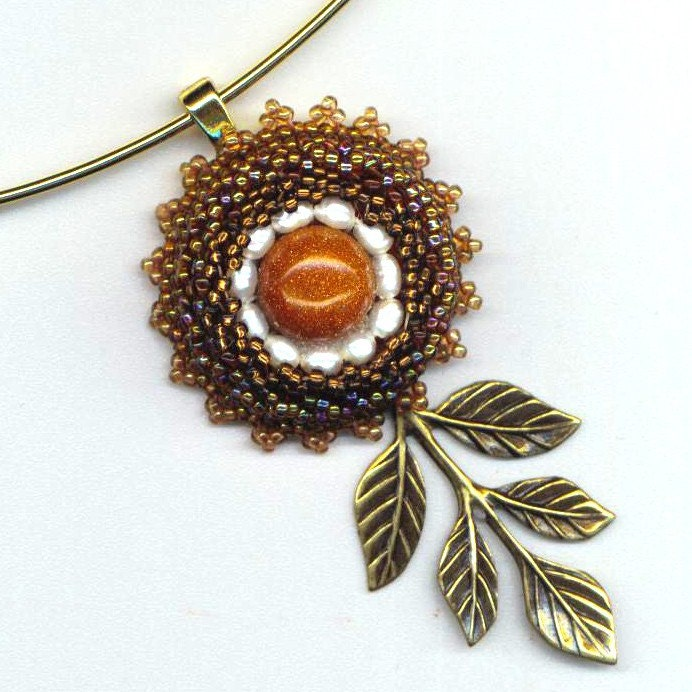 Flower for the Desert Princess -  Beaded Pendant with Goldstone and Tiny Pearls