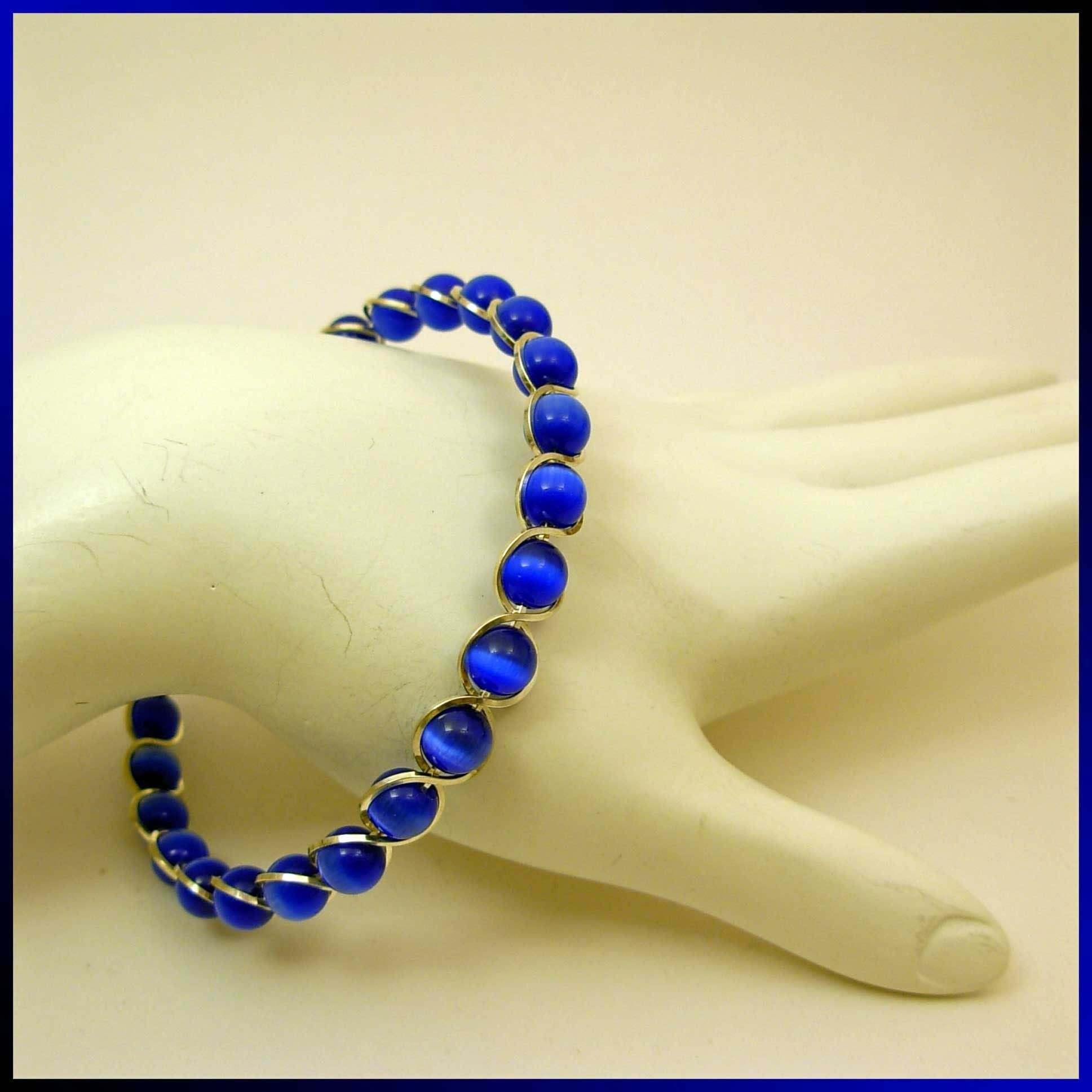Etsy - Sterling Silver Bracelet with Blue Catseye / Fiber Optic Beads
