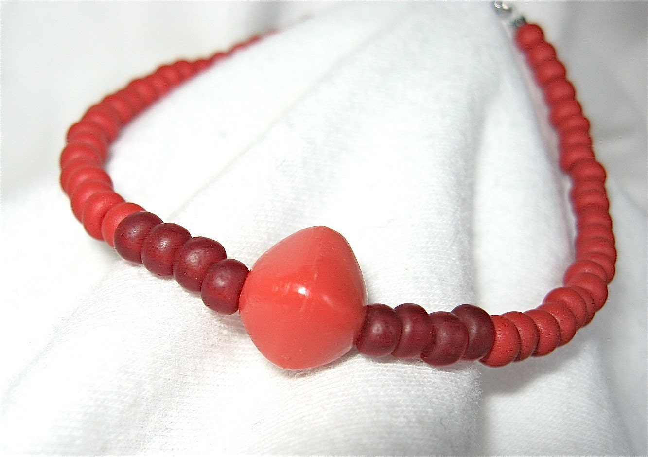 Lava Lust, Red Glass and Plastic Beaded Bracelet