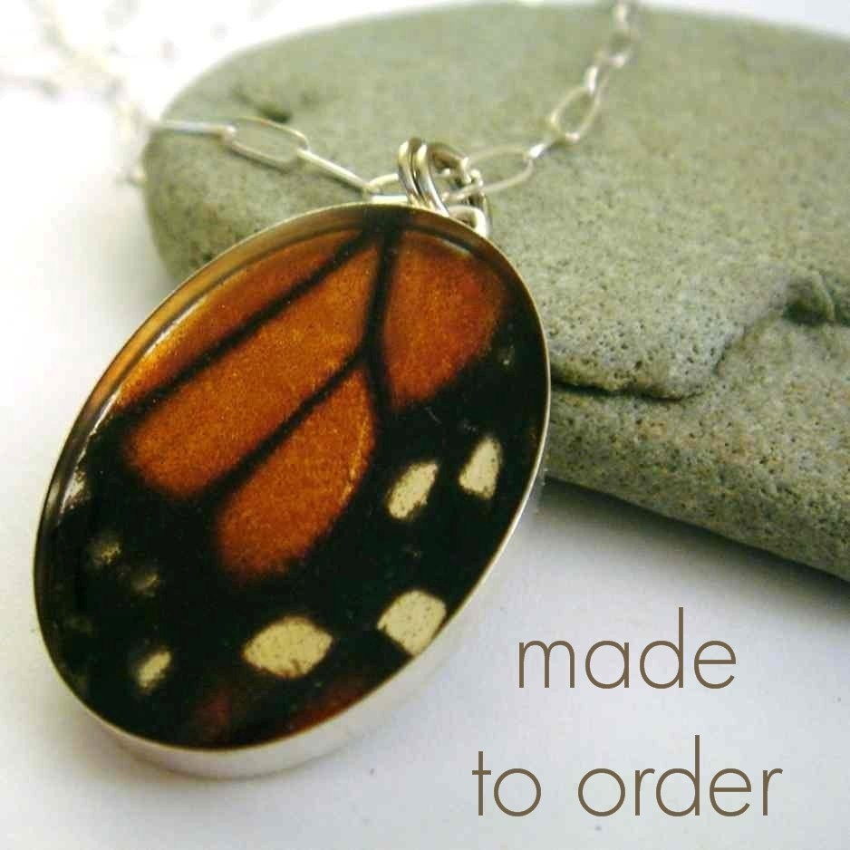 beautiful butterfly wing  necklace    fuzzy black slippers and a pink