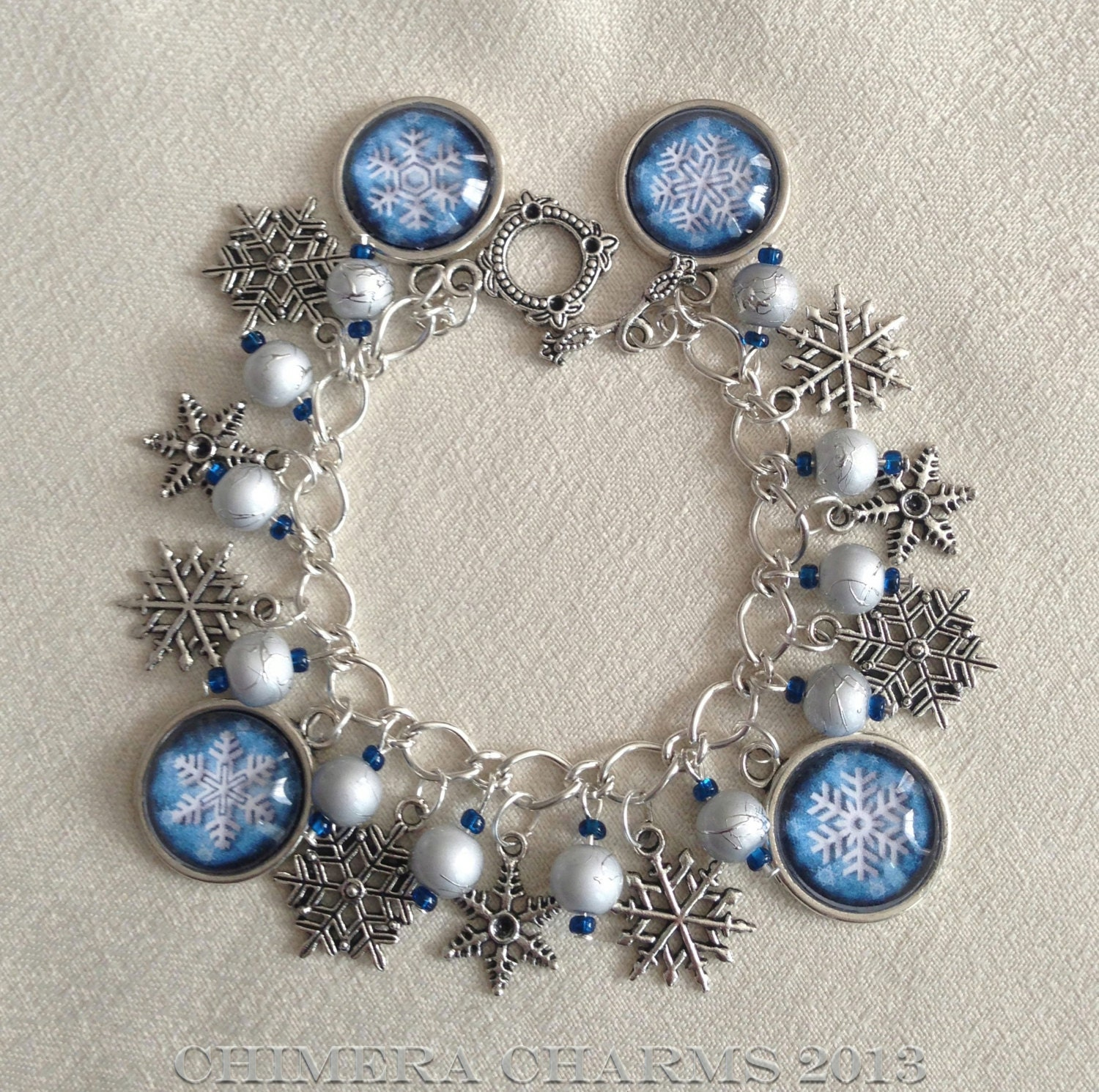 Winter Wonderland Snowflakes Charm Bracelet with Drizzled Drawbench Beads - ChimeraCharms