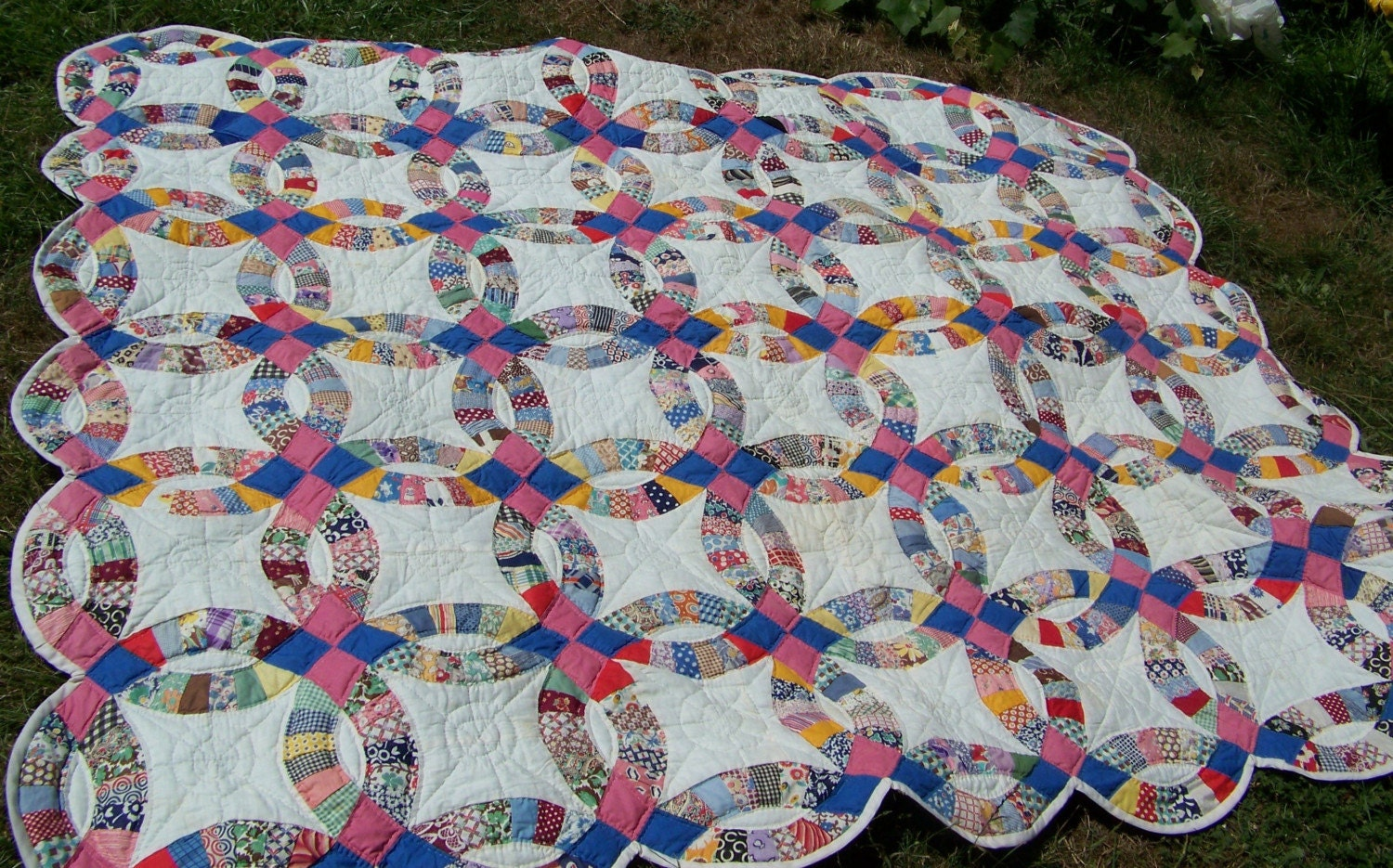 Double wedding ring quilt with a HIstory kinda vintage