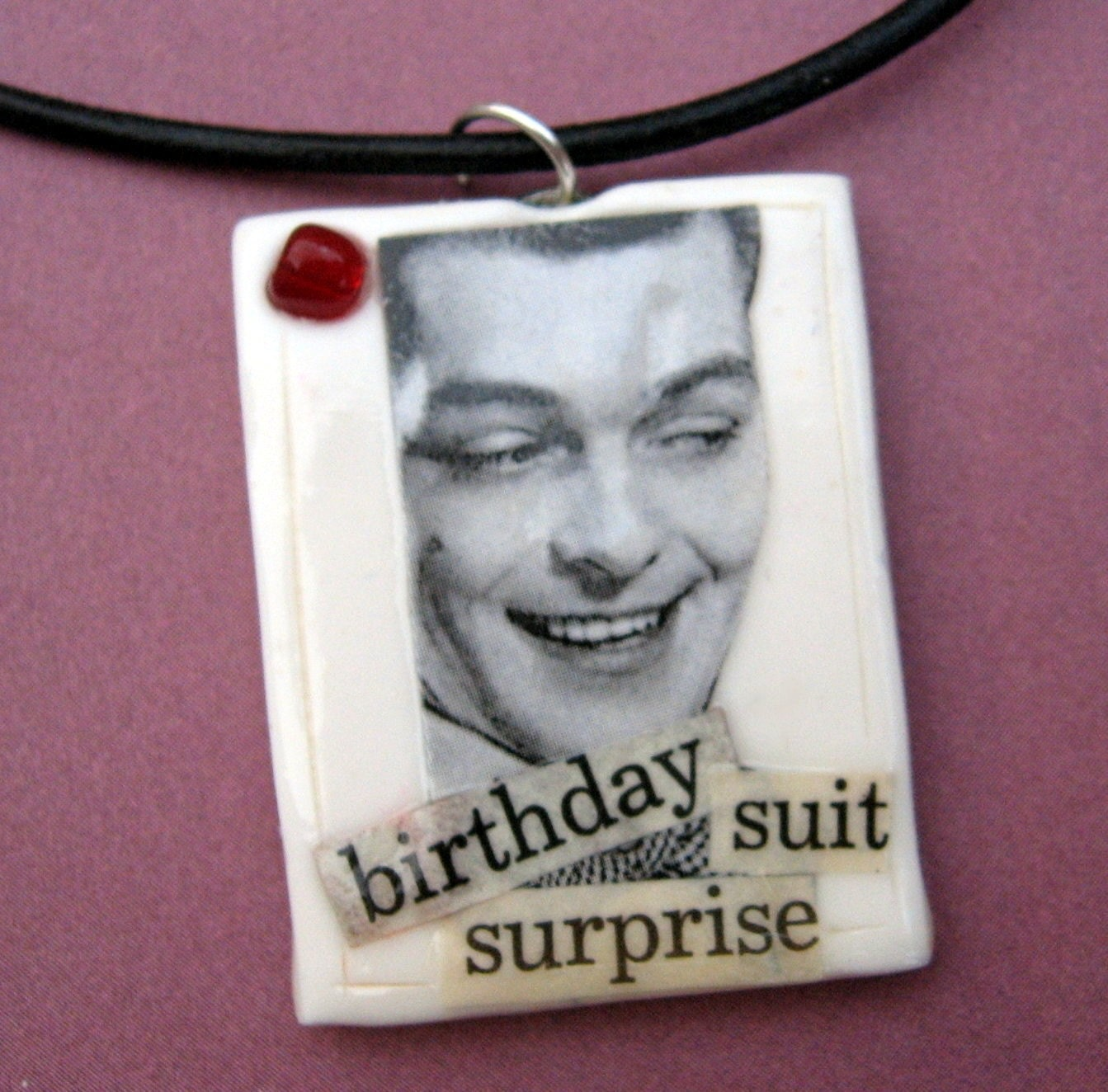 Birthday Suit Surprise pendant (on leather cord)