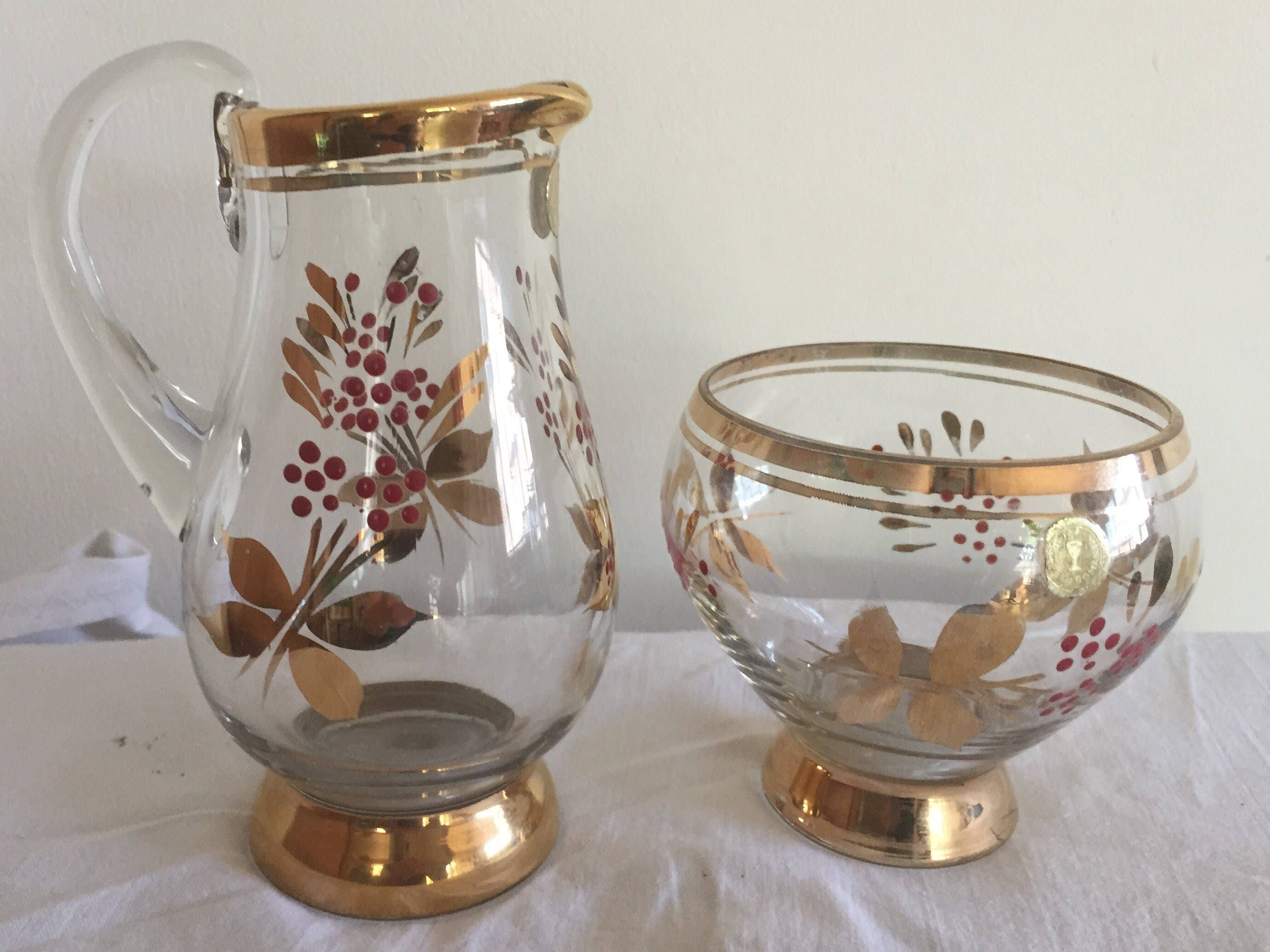 A pretty vintage Romanian Bohemian glass jug and bowl set with gold and red decor