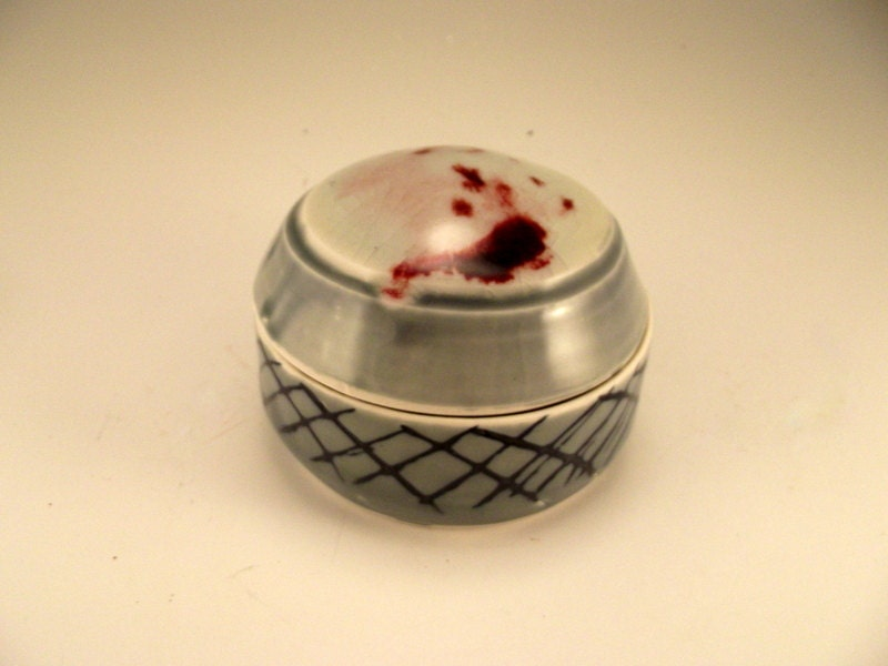 Covered cache - small covered container with a blue celadon body, and a  white crackled top, tinged with fire red
