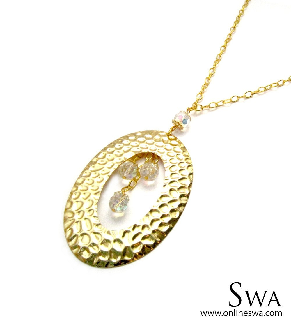 Big textured Gold Pendant with faceted glass beads