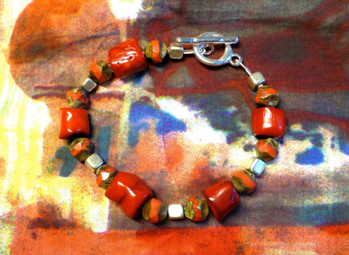 ruby red, glass  and keramic bracelet.