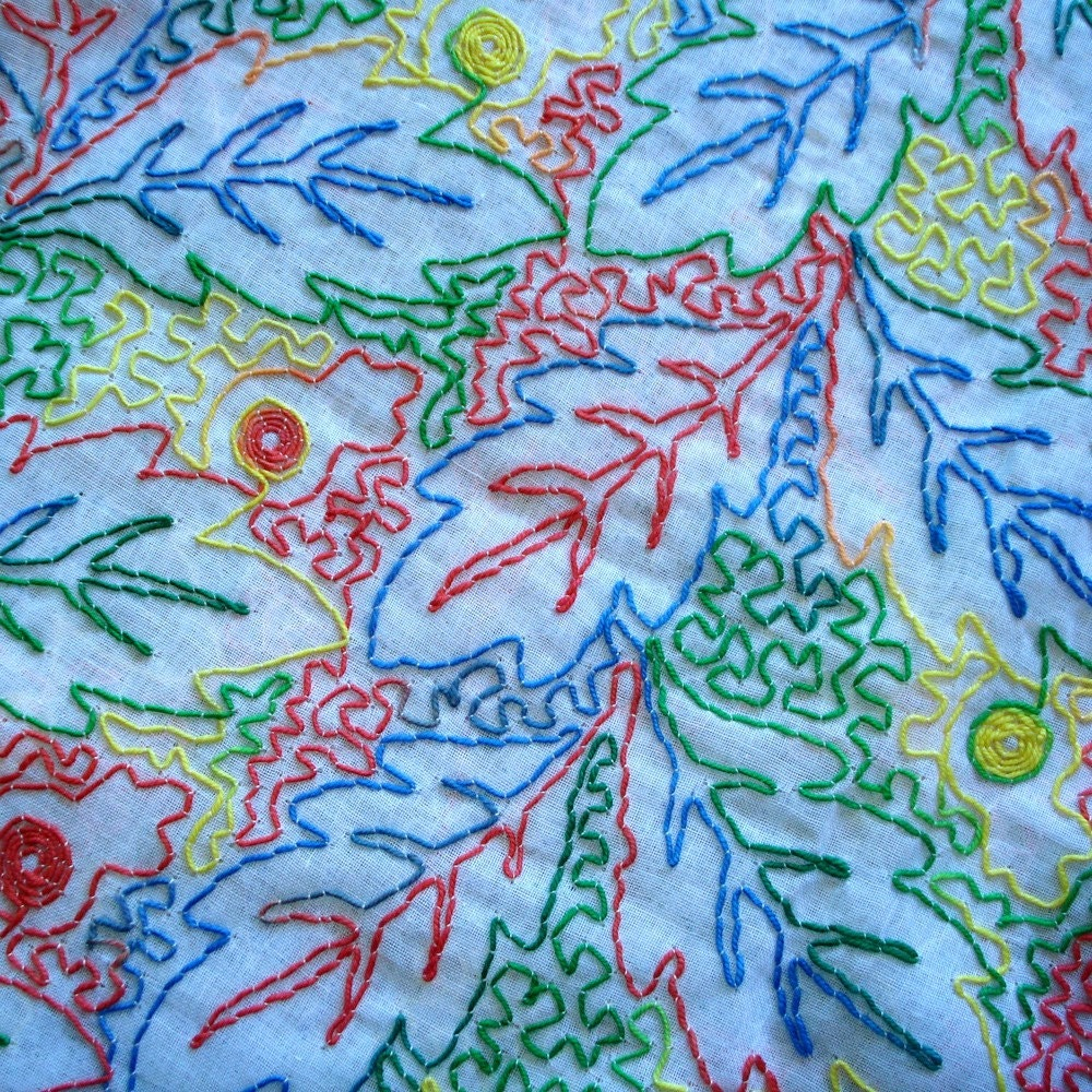 Fabric - muslin with embroidered leaf pattern - primary colors - 2 1/3 yards