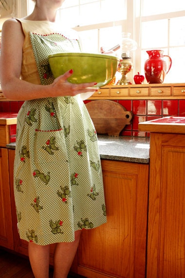 green and red vintage apron with novelty poodle pattern
