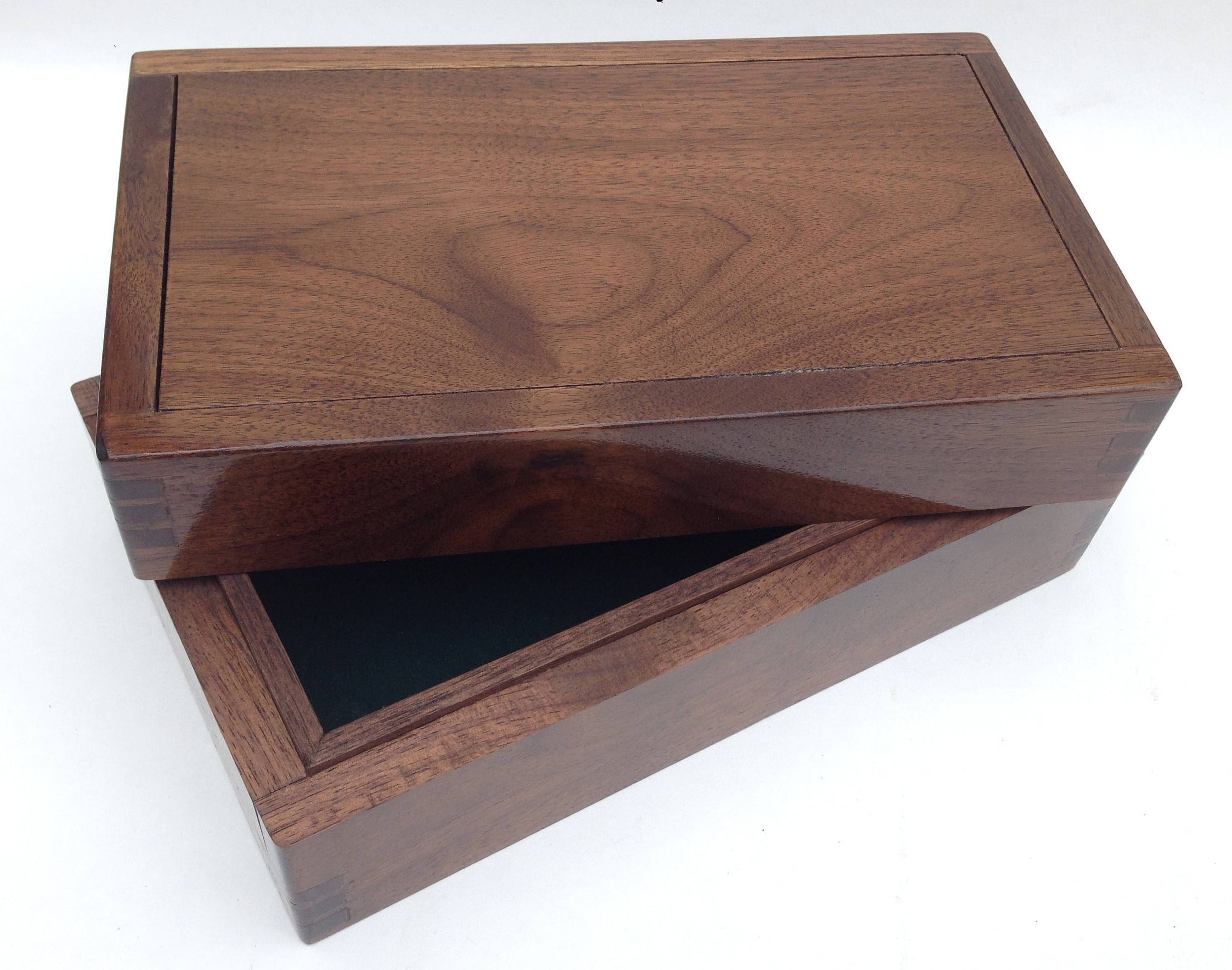 Digby A fine wooden box handmade in walnut to a contemporary. Great midsized jewellery box can be customised in wood and interior.