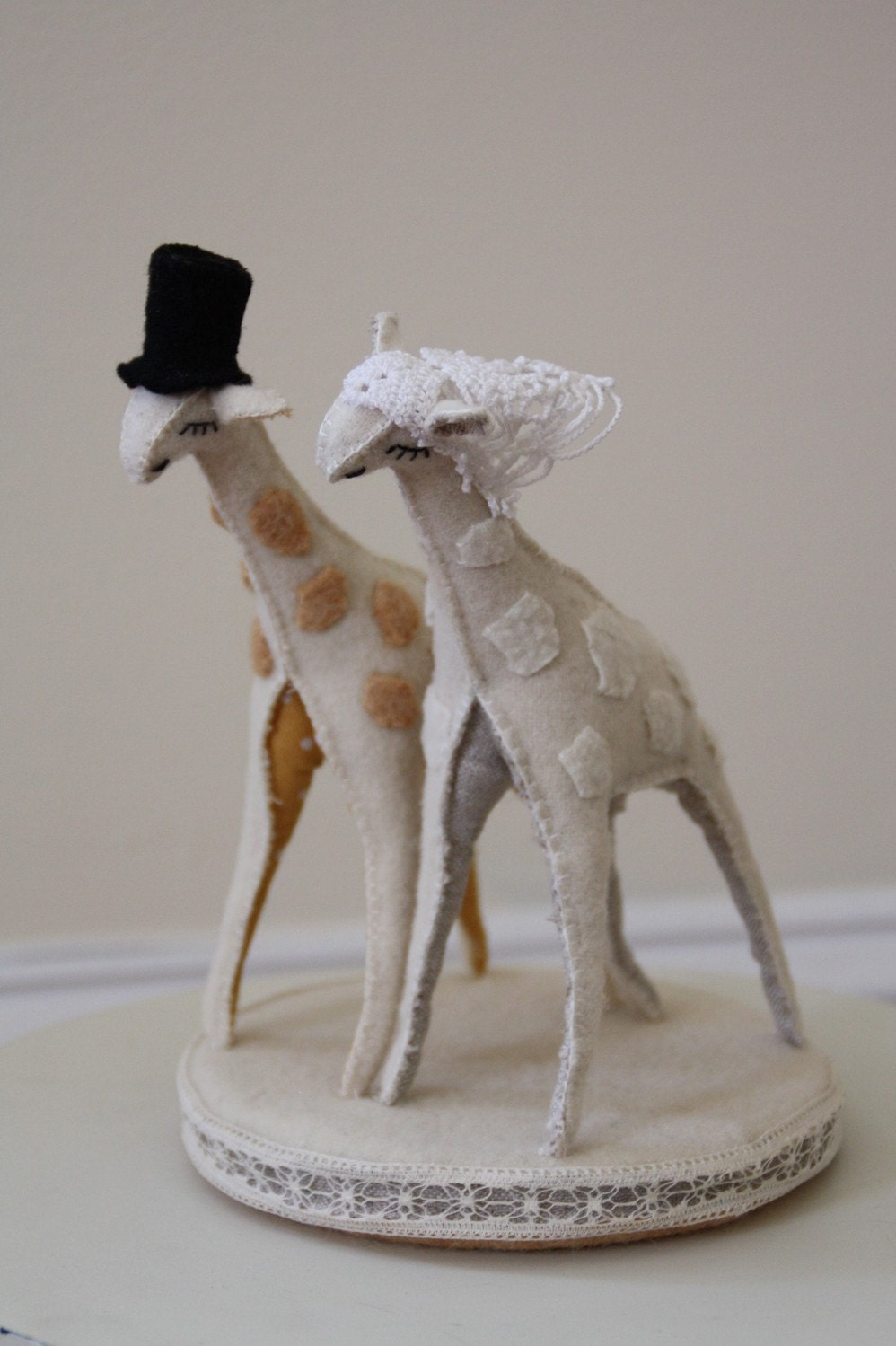 Giraffe cake topper in wool, linen and vintage lace
