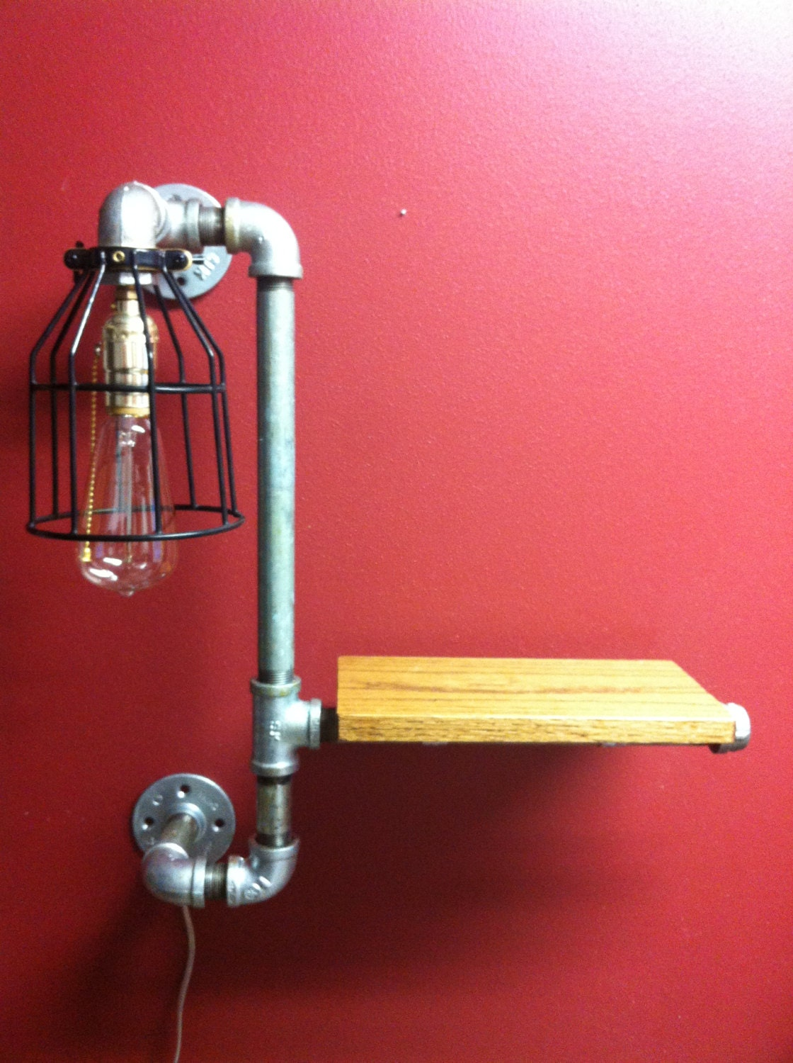 Pipe shelf light lamp sconce with bulb cage by for Pipes and lights