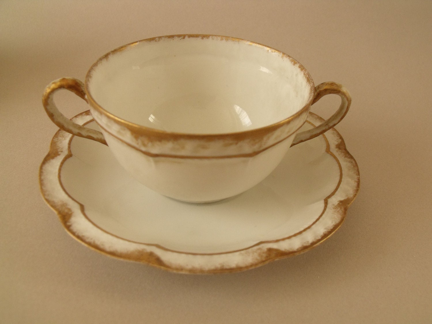 Limoges Double-Handed Cup and Saucer- Haviland & Co. France