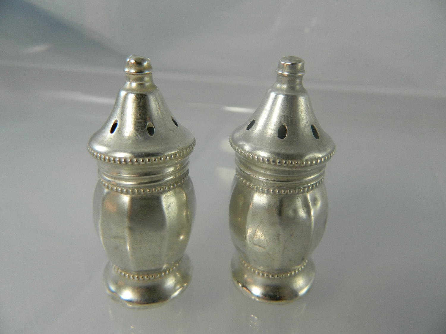 Antique Sterling Silver Salt And Pepper Shakers By