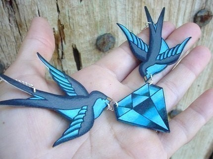 tattoo inspired blue and grey sparrows holding diamond necklace