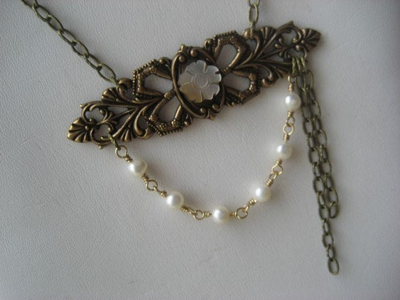 Lady of the Manor (brass filigree piece with mother of pearls flower, white pearls and brass chain strands)