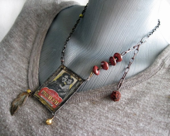 Maji. Double Sided Antique Label Pendant.