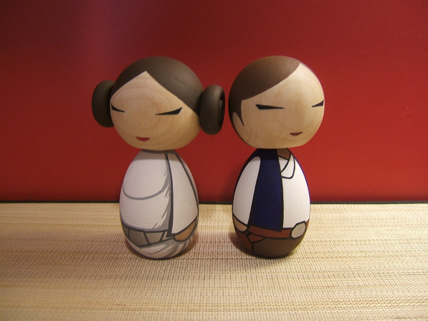 Kokeshi dolls. Han Solo and Princess Leia set.
