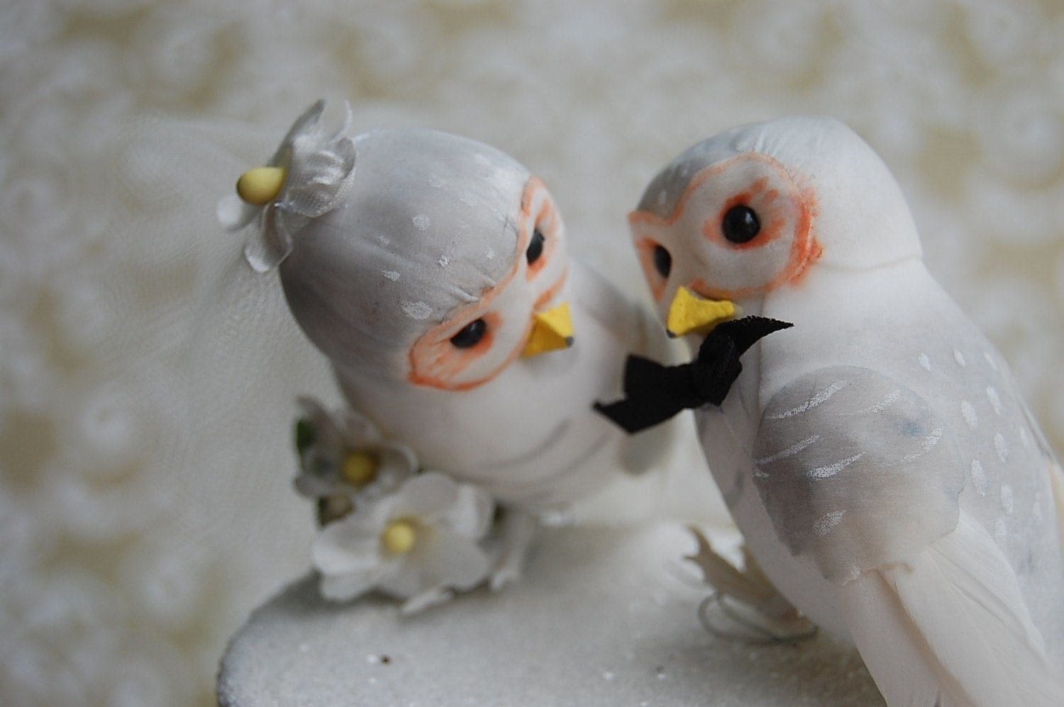 http://www.etsy.com/listing/57635506/snow-owl-love-birds-wedding-cake-topper