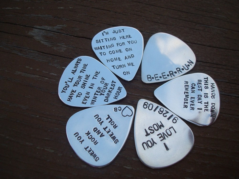 sterling silver guitar pick personalized im getting this for my fiancee will post pictures and a review of the vendor when i get it in