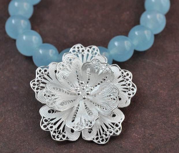 Talula Bracelet. Sterling silver filigree flower and blue aquamarine.
