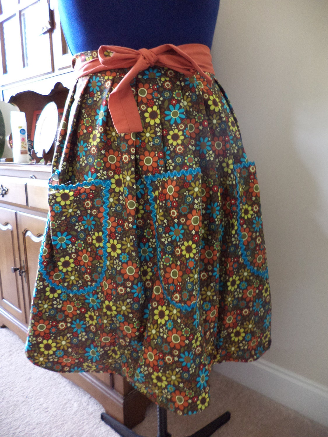 Half apron Aqua and Gold floral pattern on brown background  with burnt orange accents - BeaSewn