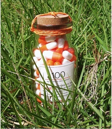 Glass Bottle with 100Days Orange Vitamin Capsule Letters