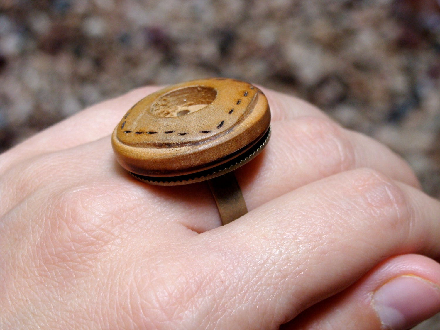 wooden ring with stitched button