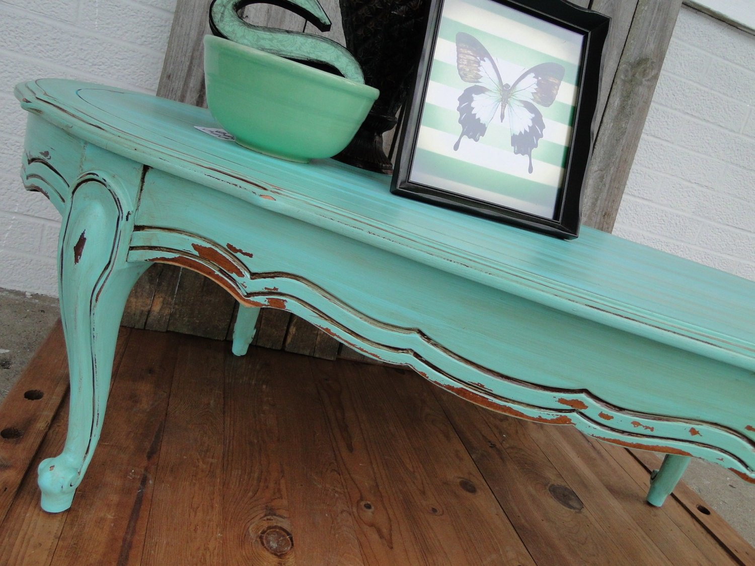 Vintage wooden oval coffee table with cuvy legs in by for Rustic beach coffee table