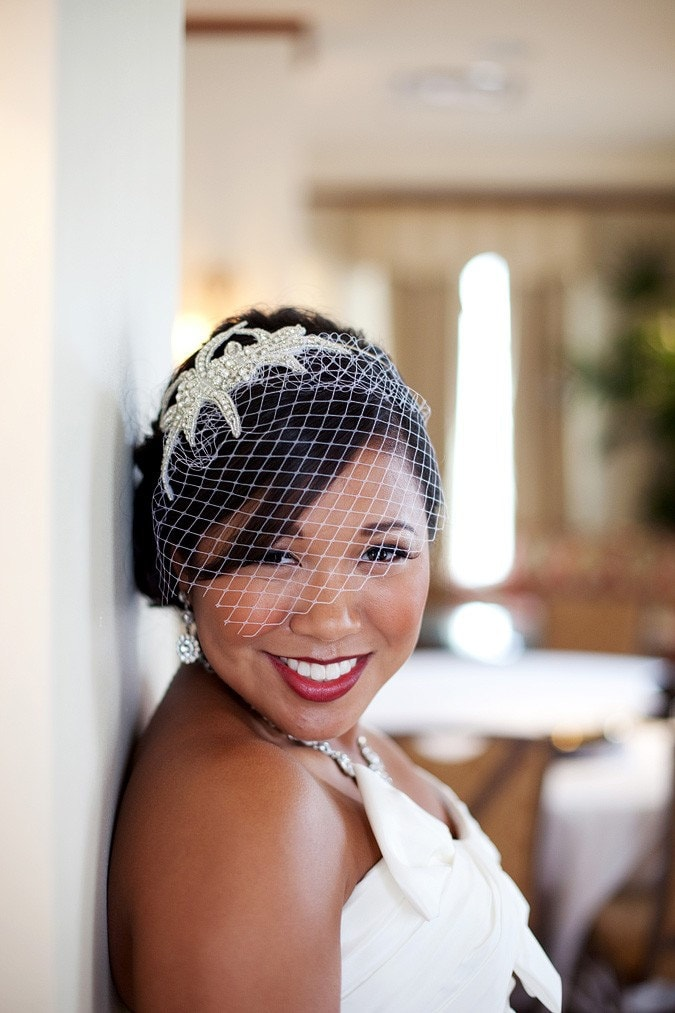 Sophia is our Bridal Couture Rhinestone, Crystal and Silver Beaded Headband with birdcage veil for your wedding