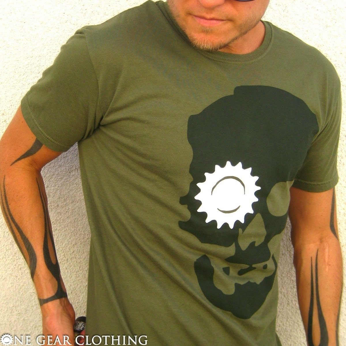 Ghost Roger - Skull with gear eye socket tee shirt - Gray and white on army green - Available in Mens / Unisex S, M, L, XL