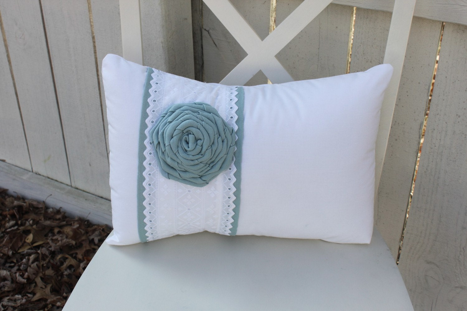 White Pillow with Eyelet Fabric Stripe & Blue Flower Rosette