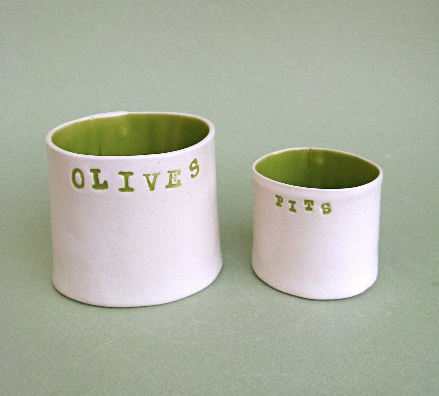 olives and pits  ....  hand built porcelain containers ...  vessels
