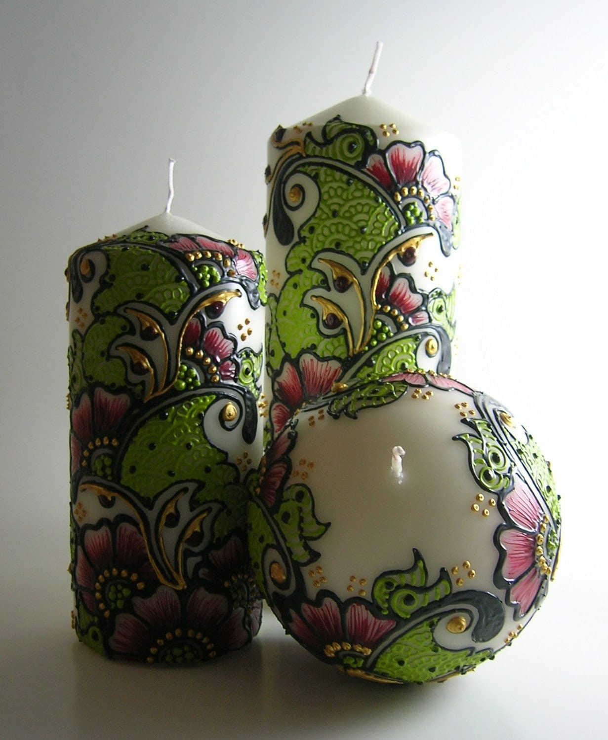 set of 3 henna inspired candles in cranberry red, pea green and buttery gold