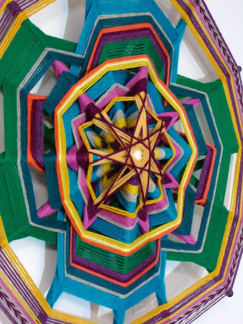 Ever Onward, a 7 stick/14-sided Ojo de Dios. 18 inches, all wool yarns