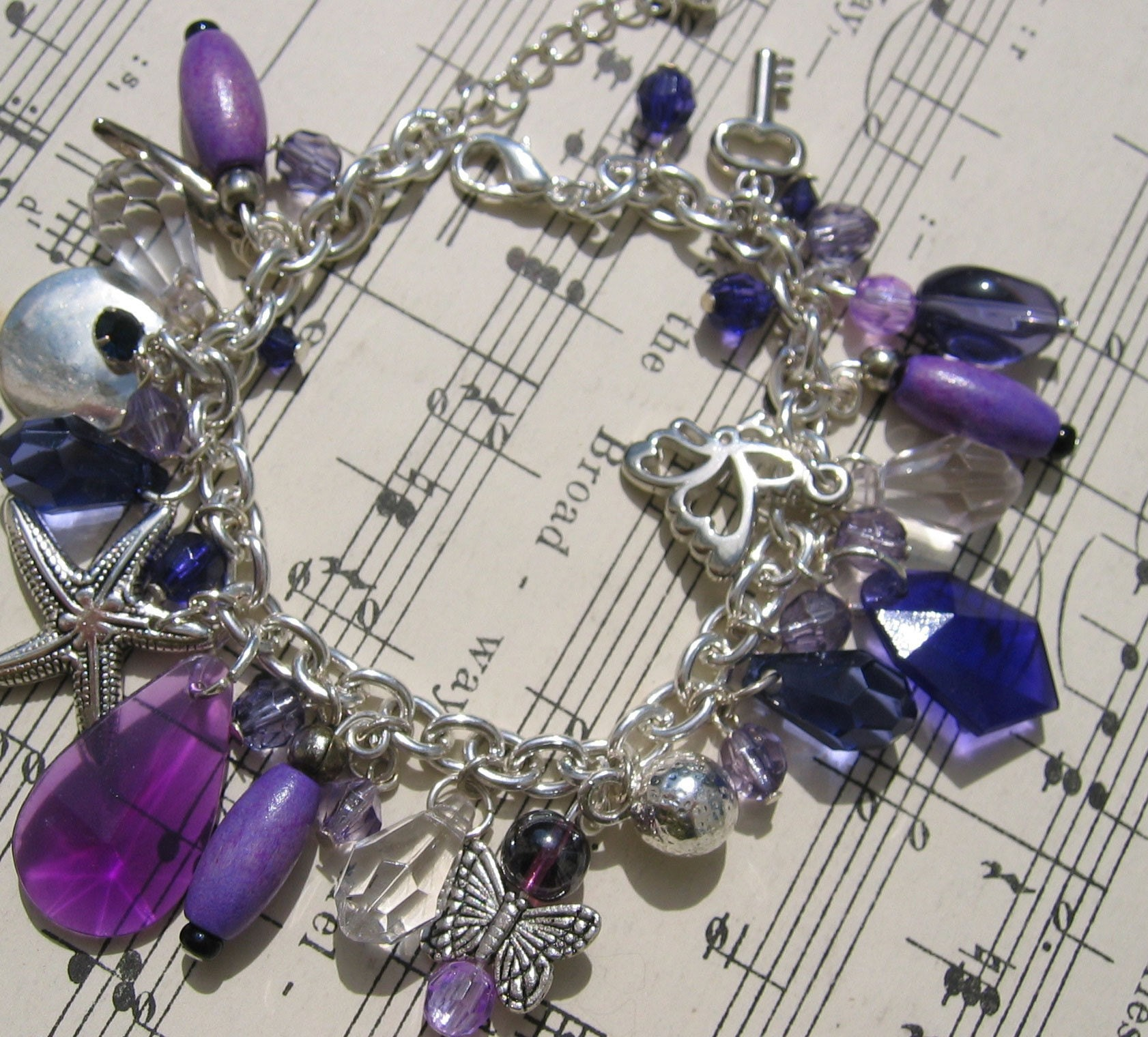 Silver and Lilac Charm bracelet