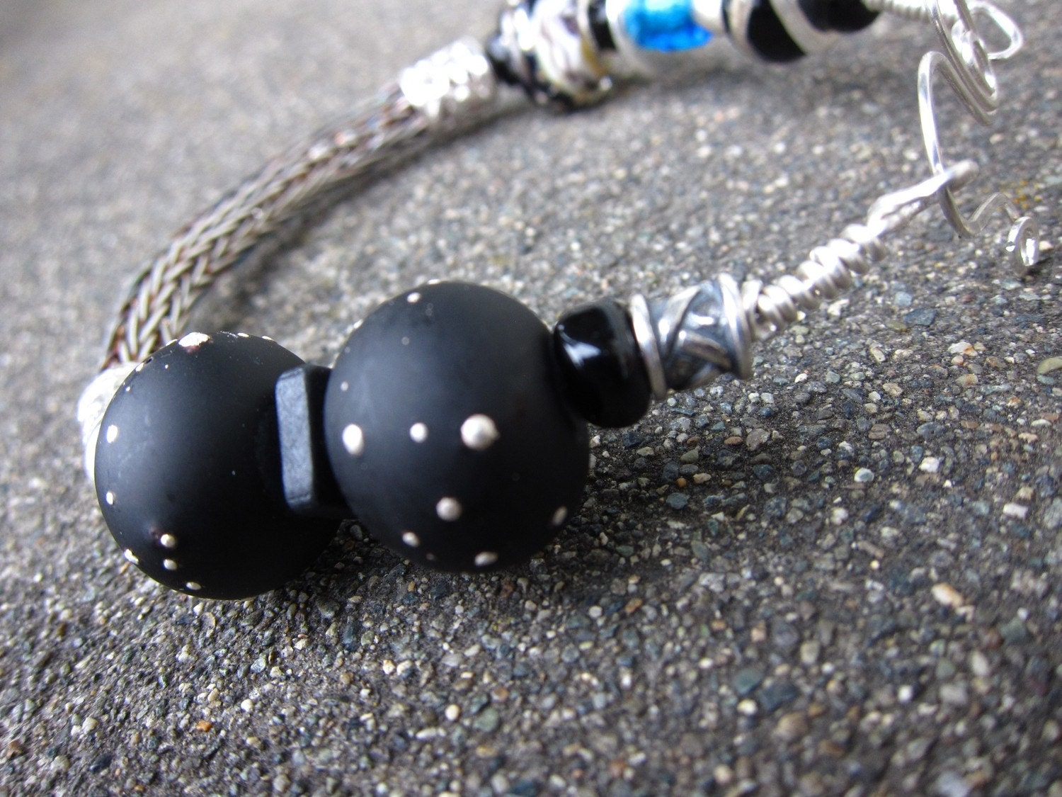 Into the Night, Sterling silver viking knit bracelet with black lampwork beads