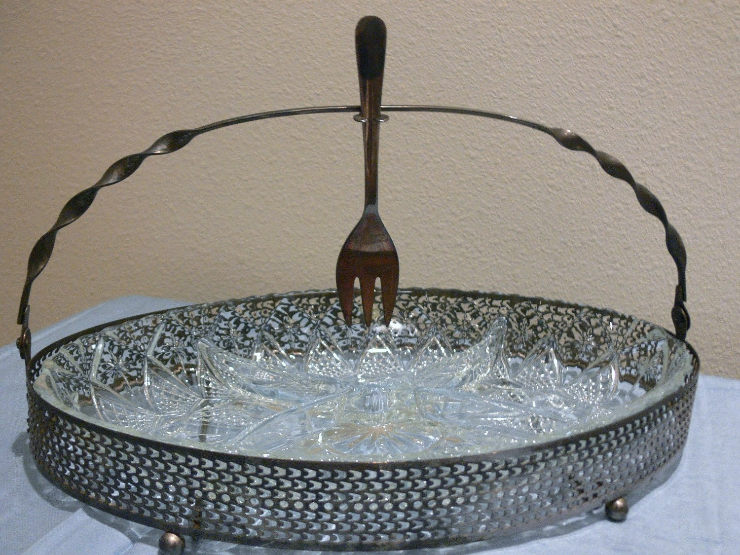 French silver and glass serving tray with fork