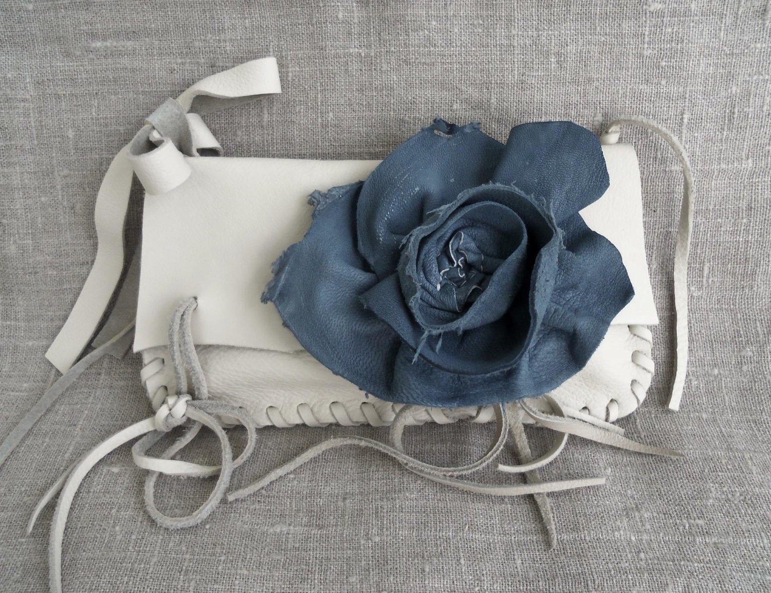 creamy white leather clutch or wristlet with denim blue rose flower by Tuscada. Ready to ship - tuscada