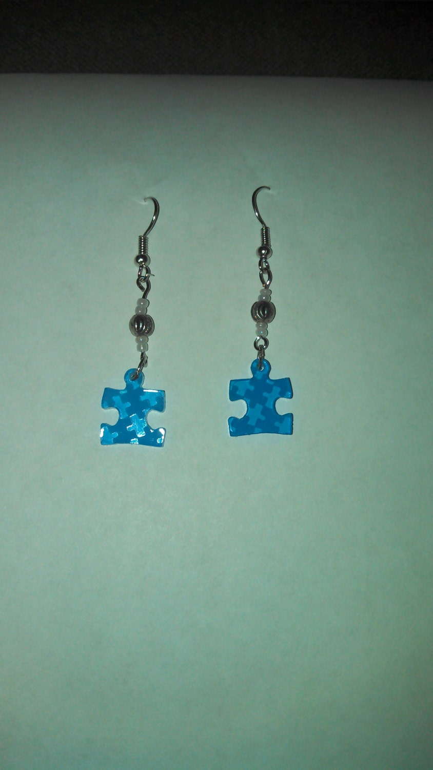 autism puzzle earrings by piasaproductions on etsy