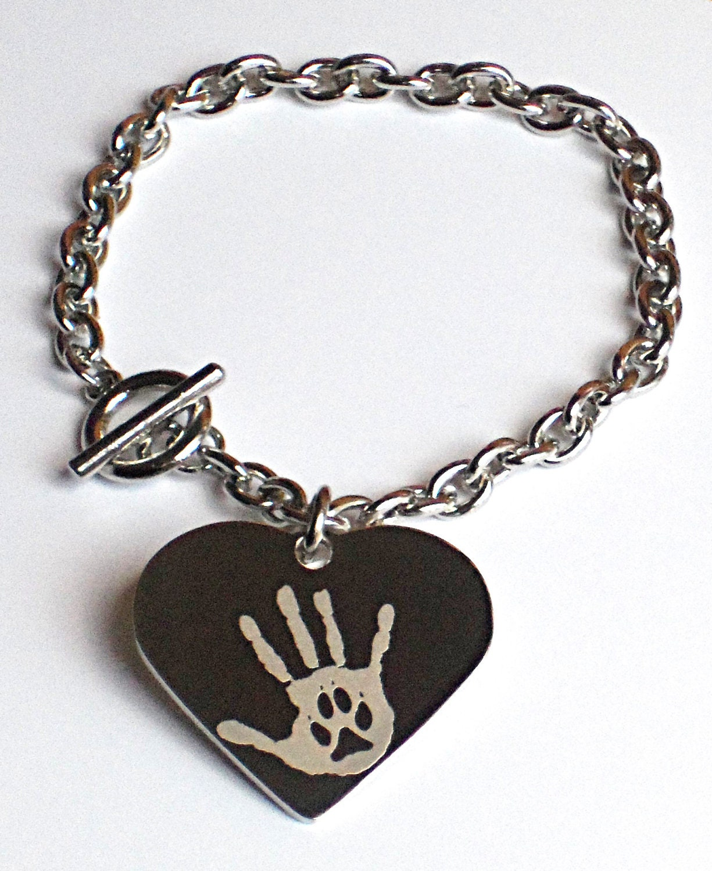 items similar to engraved paw print pendant