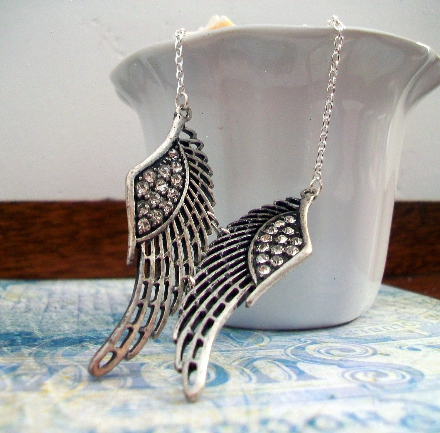 Celebrity Inspired Angel Wing Necklace in Silver by TAKCreations from etsy.com