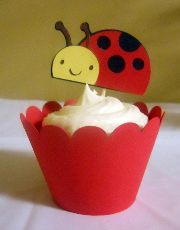 red cupcake wrapper with ladybug topper
