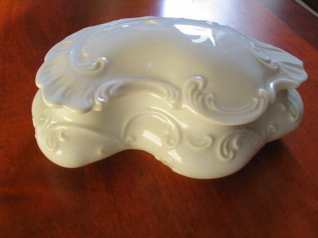 Button shaped trinket dish storage