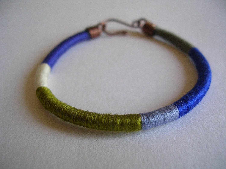 The embroiderer's bracelet: color block bracelet in cornflower blue, beige gray, olive green, lilac blue, cobalt blue and beaver gray