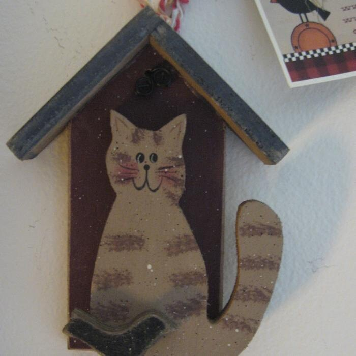 Wooden house with cat and crow