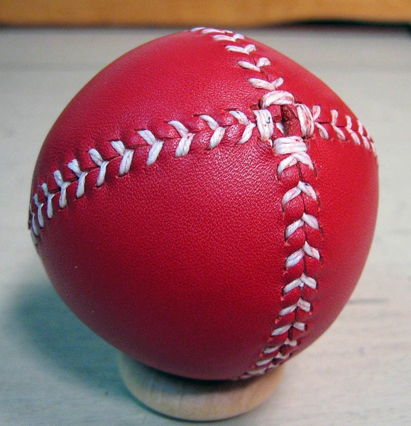 LEMON BALL Vintage style lemon peel style baseball.  Red leather with white stitches