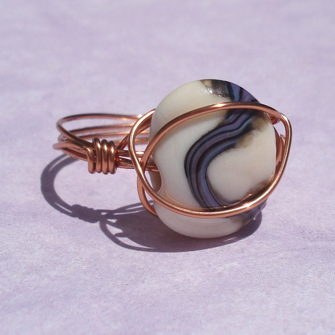 wire wrapped copper ring with artisan lampwork glass bead
