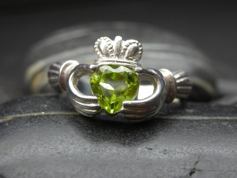 Claddagh ring with a heart shape Peridot in sterling silver