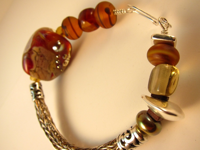 Amber Rich, Sterling Silver viking knit bracelet, lampwork beads